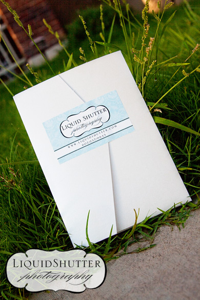 I used a pearl paper pocket wedding invitation and cut the slits for the